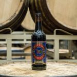 Central City Lohin McKinnon Whisky Aged Imperial Porter Bottle on Barrel